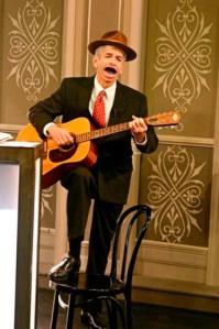 Minister van gitaar en hoed